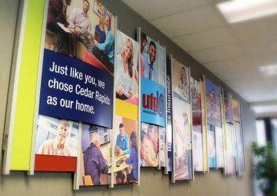 Corporate branding wall with bright photos and logos