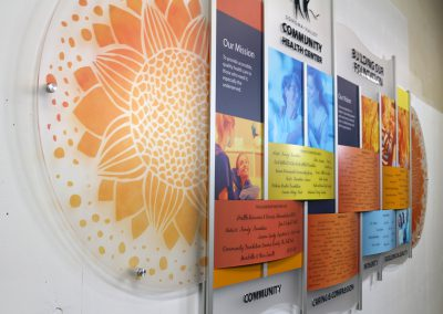 bright donor wall display in Rail Wall System by Presentations with sunflowers and raised lettering to add texture for the California medical center donor wall